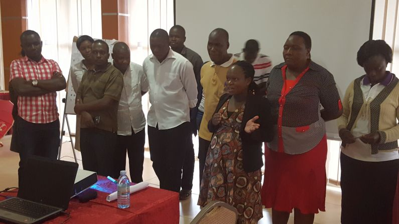Photo 3 - Participants presenting during the training